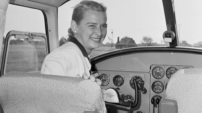 In this Oct. 14, 1960 file photo, Jerrie Cobb sits in the cockpit of a twin engine Aero Commander airplane, the advertising and sales promotion manager of the Oklahoma City's plane manufacturing company. (AP Photo)