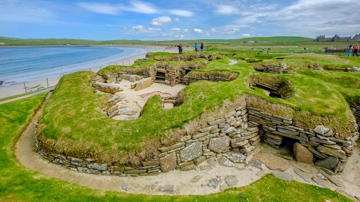 Tourists visiting Skara Brae, a Neolithic settlement located in the Mainland Orkney. In this prehistoric village, one of the best preserved groups of prehistoric houses in Western Europe, people can see the way of life of 5,000 years ago, before Stonehenge was built. (Credit: iStock)