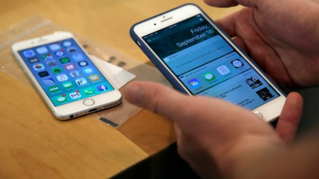 FILE - In this Friday, Sept. 16, 2016, file photo, a customer sets up his iPhone 7 Plus, right, as he switches from an iPhone 6. (AP Photo/Kiichiro Sato, File)