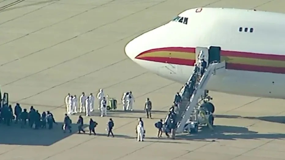 Flight with Americans evacuated from China over coronavirus lands ...