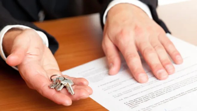 Handing Over Keys Business Sale or Apartment Rental