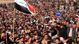 Tens of thousands of Iraqi Sunnis angry over perceived second-class treatment by the Shiite-led government massed along a major western highway and elsewhere in the country Friday for the largest protests yet in a week of demonstrations.