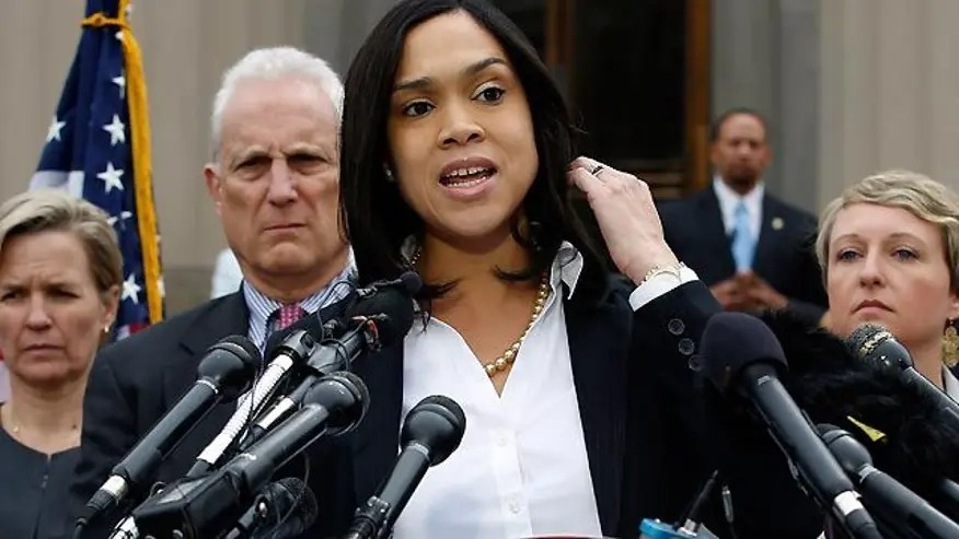 Baltimore prosecutor charges police with murder manslaughter in death