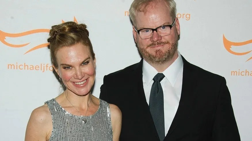 """In this Nov. 22, 2014 file photo, Jeannie Gaffigan, left, and Jim Gaffigan attend The Michael J. Fox Foundation for Parkinson's Research benefit, """"A Funny Thing Happened on the Way to Cure Parkinson's,"""" in New York. Gaffigan says his wife and writing partner Jeannie is recovering after surgery to remove a serious brain tumor."""