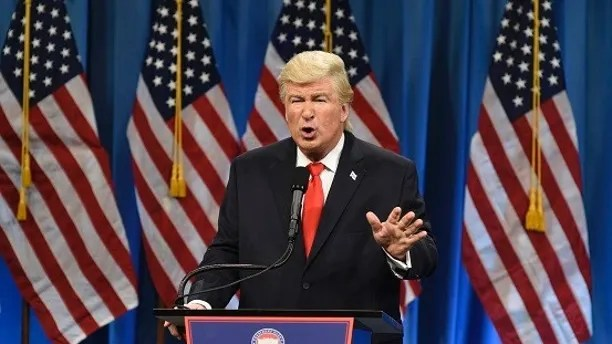 "This Jan. 14, 2017 photo released by NBC shows Alec Baldwin President Elect Donald J. Trump in a sketch on ""Saturday Night Live,"" in New York.  Baldwin was nominated for an Emmy Award for outstanding supporting actor in a comedy series on Thursday, July 13, 2017. The Emmy Awards ceremony, airing Sept. 17 on CBS, will be hosted by Stephen Colbert. (Will Heath/NBC via AP)"