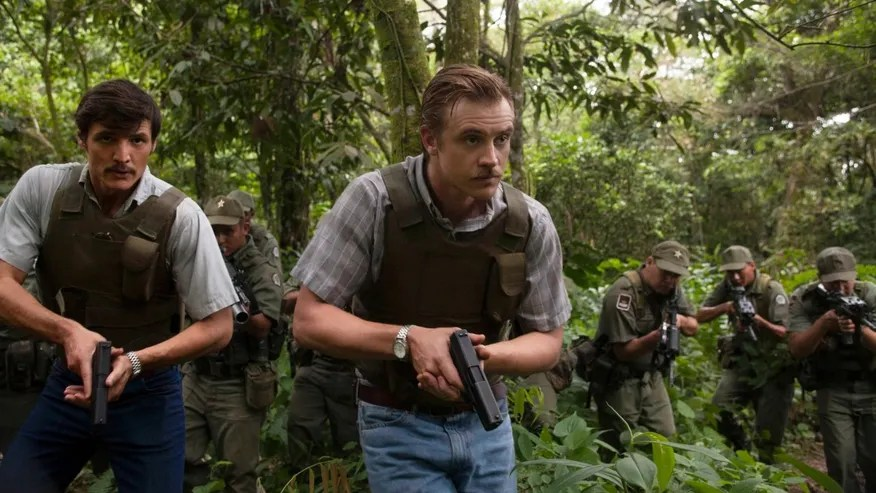 """This undated production photo provided by Netflix, shows actors Pedro Pascal, left, as Javier Pena, and Boyd Holbrook as Steve Murphy in the Netflix Original Series """"Narcos.""""  The series that debuts on Aug. 28, 2015, is based on the account of Murphy and Pena, now-retired Drug Enforcement Administration agents who were assigned to bring the drug lord down. (Daniel Daza/Netflix via AP)"""