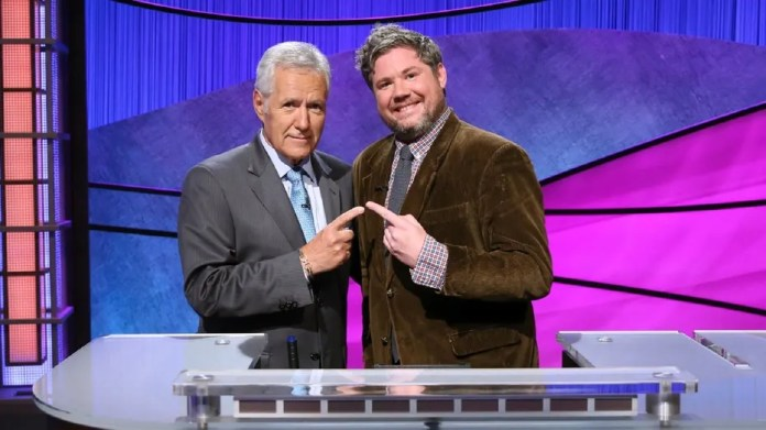 """""""Jeopardy!"""" contestant Austin Rogers, right, had a 12-game winning streak before losing by $51 Thursday night."""