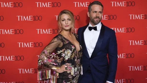 FILE - In this April 25, 2017 file photo, actress Blake Lively wears a Marchesa dress as she poses with her husband Ryan Reynolds at the TIME 100 Gala in New York. Marchesa co-founder Georgina Chapman took what some believed was her only brand-saving leap Tuesday, Oct. 10, 2017, as sex abuse allegations against her husband Harvey Weinstein mounted. Breaking her six-day silence, she told People she was leaving the film mogul she married in 2007. The divorce revelation came as some on social media called for a Marchesa boycott. (Photo by Charles Sykes/Invision/AP, File)