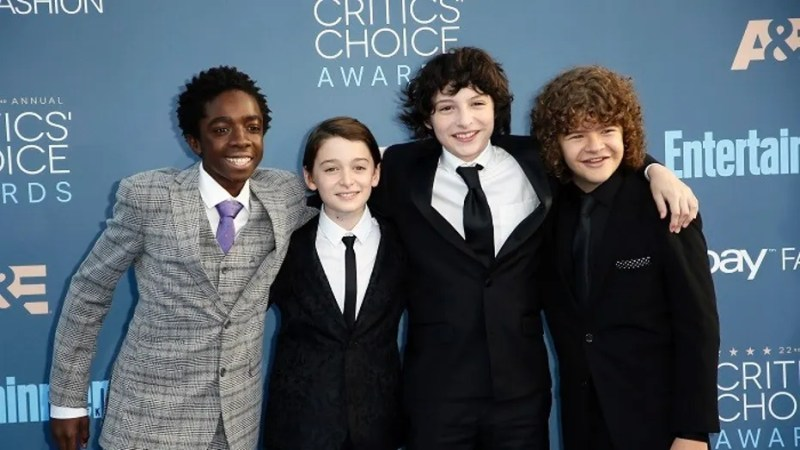 """""""Stranger Things"""" star Finn Wolfhard (pictured second from right) fired his agent who was accused of sexual assault."""