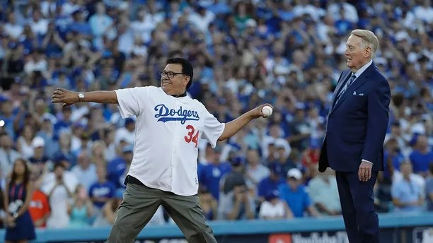 Vin Scully and Fernando Valenzuela throw out the ceremonial first pitch before Game 2 of baseball's World Series between the Houston Astros and the Los Angeles Dodgers Wednesday, Oct. 25, 2017, in Los Angeles. (AP Photo/David J. Phillip)