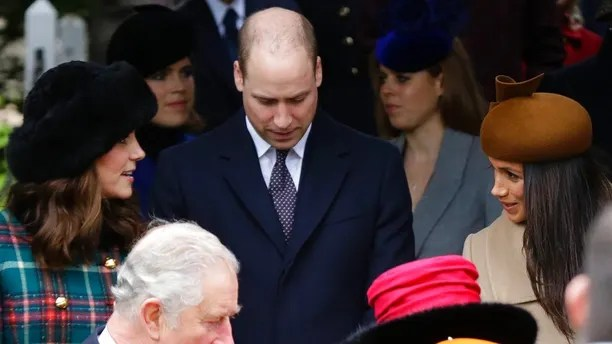 Kate, Duchess of Cambridge, left, talks to Meghan Markle, Prince Harry's fiancee, right, as they wait with Prince William, centre, for the Queen to leave by car following the traditional Christmas Day church service, at St. Mary Magdalene Church in Sandringham, England, Monday, Dec. 25, 2017. (AP Photo/Alastair Grant)