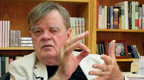 """FILE - In this July 26, 2017, file photo, Garrison Keillor, creator and former host of, """"A Prairie Home Companion,"""" talks at his St. Paul, Minn., office. Keillor says he is in negotiations with Minnesota Public Radio after the radio network cut ties with him over unspecified allegations of inappropriate behavior. Keillor wrote on his Facebook page Friday, Jan. 5, 2018, that a second day of mediation was held at a law firm in downtown Minneapolis, but he provided no details. (AP Photo/Jeff Baenen, File)"""