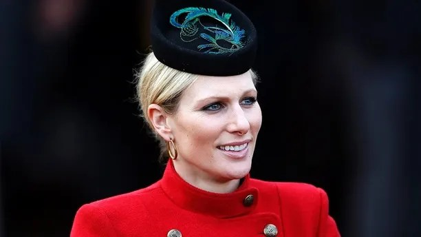 Britain's Zara Phillips smiles in the unsaddling enclosure on Ladies Day at the Cheltenham Festival horse racing meet in Gloucestershire, western England,  March 13, 2013.  REUTERS/Stefan Wermuth (BRITAIN - Tags: SPORT HORSE RACING ROYALS) - GM1E93E002Q01