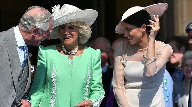Meghan, Duchess of Sussex attends a garden party at Buckingham Palace, with Camilla the Duchess of Cornwall and Prince Charles, in London, Britain May 22, 2018.  Dominic Lipinski/Pool via Reuters - RC158DAC26A0