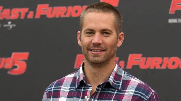 """FILE - In this April 29, 2011 file photo, actor Paul Walker poses during the photo call of the movie """"Fast and Furious 5,"""" in Rome.  A coroner's report says the Porsche carrying Walker may have been going 100 mph or more before it crashed, killing both Walker and the driver. The report released Friday, Jan. 3, 2014, by the Los Angeles County coroner's office says that Roger Rodas, Walker's friend and financial adviser, was driving the 2005 Porsche Carrera GT at an unsafe speed, estimated by witnesses to be 100 mph or more. (AP Photo/Andrew Medichini, File)"""