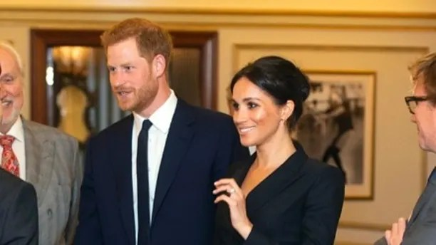 Britain's Prince Harry and Meghan, Duchess of Sussex Victoria Palace Theatre before attending a gala performance of the musical Hamilton, in support of the charity Sentebale, in London, Wednesday, Aug. 29 2018. The evening will raise awareness and funds for Sentebale's work with children and young people affected by HIV in southern Africa. (Dan Charity/Pool Photo via AP)