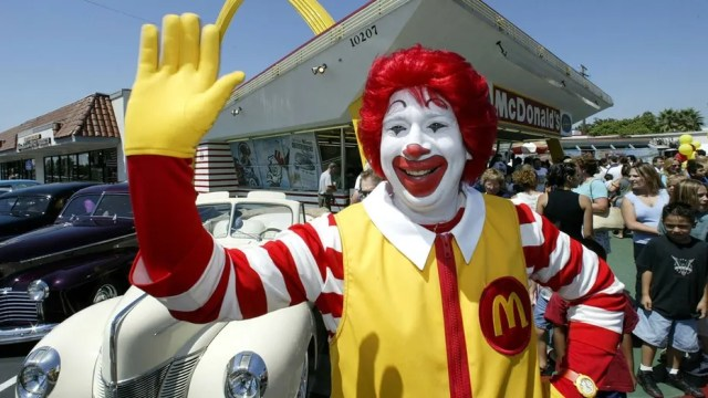 """15 men dressed as Ronald McDonald mobbed the Burger King """"for a laugh,"""" says a witness."""
