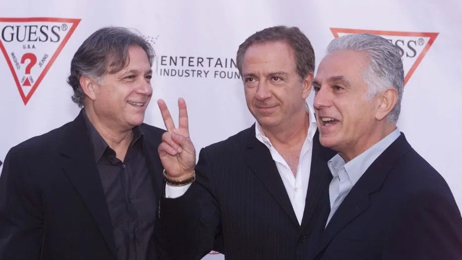 Armand (L) Paul (C) and Maurice Marciano, founders of the GUESS?