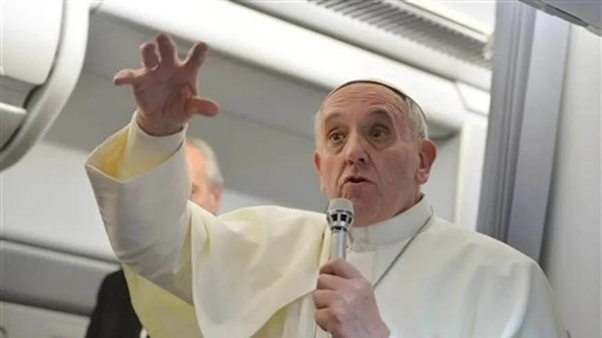 July 29, 2013: Pope Francis gestures as he answers reporters questions during a news conference aboard the papal flight on the journey back from Brazil.