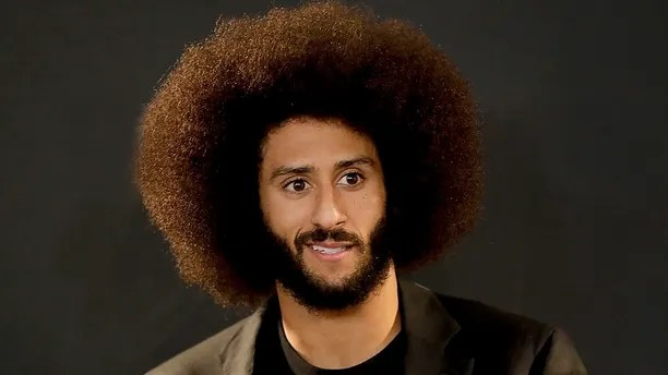 "FILE - In this Dec. 24, 2016, file photo San Francisco 49ers quarterback Colin Kaepernick talks during a news conference after an NFL football game against the Los Angeles Rams. The free agent quarterback was named GQ magazine's ""Citizen of the Year"" for his activism on Nov. 13, 2017. (AP Photo/Rick Scuteri, File)"