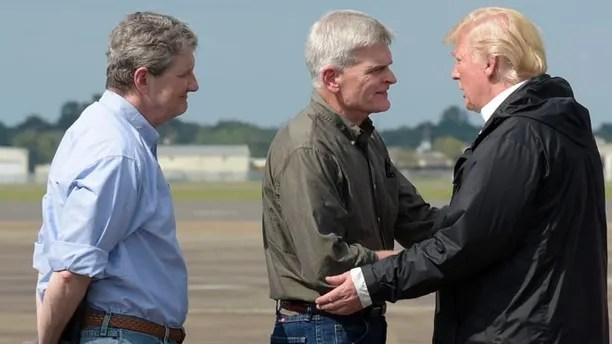 President Donald Trump, right, talks with Sen. Bill Cassidy, R-La., center, and Sen. John Kennedy, R-La., after arriving at Chennault International Airport in Lake Charles, La., to meet people at a county emergency operations center dealing with the impacted of Hurricane Harvey, Saturday, Sept. 2, 2017. (AP Photo/Susan Walsh)