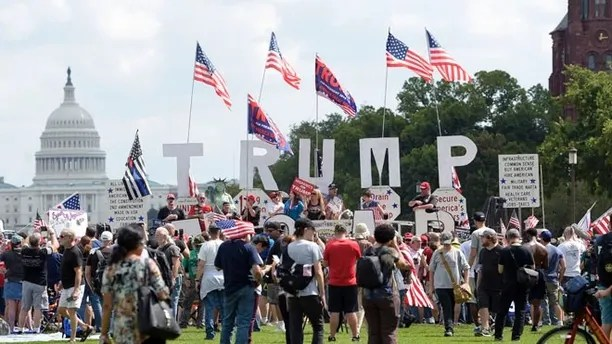 People gather on the National Mall in Washington, Saturday, Sept. 16, 2017, to attend a rally in support of President Donald Trump in what organizers are calling 'The Mother of All Rallies.