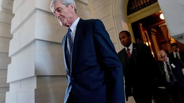 FILE- In this June 21, 2017, file photo, former FBI Director Robert Mueller, the special counsel probing Russian interference in the 2016 election, departs Capitol Hill following a closed door meeting in Washington. A grand jury used by Mueller has heard secret testimony from a Russian-American lobbyist who attended a June 2016 meeting with President Donald Trump's eldest son, The Associated Press has learned. (AP Photo/Andrew Harnik, File)