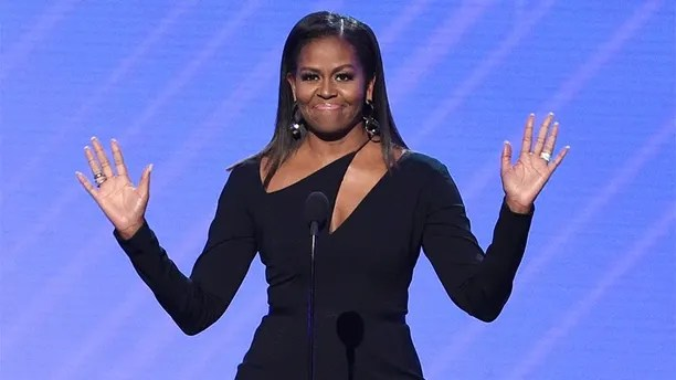 "FILE - In this July 12, 2017, file photo, former first lady Michelle Obama presents the Arthur Ashe Courage Award at the ESPYS at the Microsoft Theater in Los Angeles. Obama said at a women's conference in Philadelphia on Oct. 3, 2017, that the lack of diversity among some segments of the political landscape is a reason that ""people don't trust politics."" (Photo by Chris Pizzello/Invision/AP, File)"
