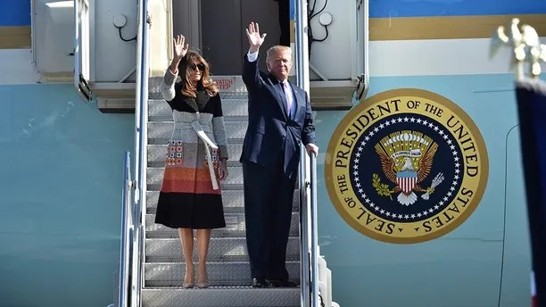 U.S. President Donald Trump, right, and first lady Melania Trump, left, wave on their arrival at the U.S. Yokota Air Base, on the outskirts of Tokyo, Sunday, Nov. 5, 2017.  President Trump arrived in Japan Sunday on a five-nation trip to Asia, his second extended foreign trip since taking office and his first to Asia. The trip will take him to Japan, South Korea, China, Vietnam and Philippines for summits of the Asia-Pacific Economic Cooperation (APEC) and the Association of Southeast Asian Nations (ASEAN). (Kazuhiro Nogi/Pool Photo via AP)