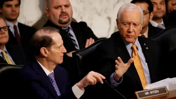"""Sen. Orrin Hatch (R-UT) speaks with Sen. Ron Wyden (D-OR) during a markup on the """"Tax Cuts and Jobs Act"""" on Capitol Hill in Washington, U.S., November 15, 2017. REUTERS/Aaron P. Bernstein - RC1EBBBFC720"""