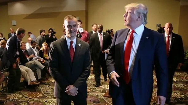 FILE - In this Aug. 25, 2015 file photo, Republican presidential candidate Donald Trump, right, walks with his campaign manager Corey Lewandowski after speaking at a news conference in Dubuque, Iowa.  Breitbart News reporter Michelle Fields, who said that she was grabbed by Lewandowski as she attempted to question Trump  in Florida on Tuesday, March 8,  has resigned from the conservative website, saying that she can't work for an organization that doesn't support her. (AP Photo/Charlie Neibergall, File)
