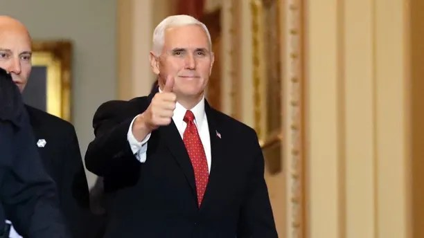 Vice President Mike Pence gives thumbs up after attending the republican caucus luncheon on Capitol Hill, Tuesday, Dec. 19, 2017 in Washington. (AP Photo/Alex Brandon)