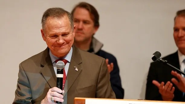 Republican U.S. Senate candidate Roy Moore pauses as he addresses supporters at his election night party in Montgomery, Alabama, U.S., December 12, 2017. REUTERS/Jonathan Bachman - RC1EEEE586B0
