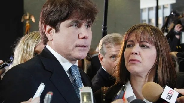 FILE - In this Dec. 7, 2011 file photo, former Illinois Gov. Rod Blagojevich, left, speaks to reporters as his wife, Patti, listens at the federal building in Chicago, after Blagojevich was sentenced to 14 years on 18 corruption counts. On Monday, March 28, 2016, the U.S. Supreme Court rejected Blagojevich's appeal of his corruption convictions that included his attempt to sell the vacant Senate seat once occupied by President Barack Obama. (AP Photo/M. Spencer Green, File)