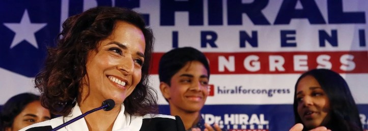 Democratic candidate for the 8th Congressional District, Dr. Hiral Tipirneni, left, greets supporters, with two of her children, Anjali, right, and Jalan, middle, looking on, after polls closed in her run against Republican Debbie Lesko as each candidate looks to fill the seat vacated by Republican Rep. Trent Franks in a special election Tuesday, April 24, 2018, in Glendale, Ariz. (AP Photo/Ross D. Franklin)