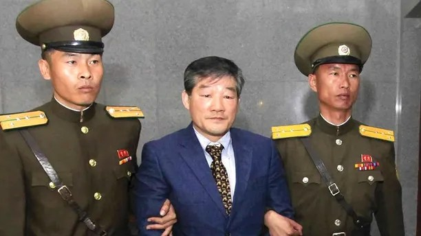 FILE - In this April 29, 2016, file photo, Kim Dong Chul, center, a U.S. citizen detained in North Korea, is escorted to his trial in Pyongyang, North Korea. President Donald Trump added to the speculation that North Korea may make a goodwill gesture before his planned summit with Kim Jong Un when he tweeted of a potential update soon on the status of three detained Americans, including Kim Dong Chul. (AP Photo/Kim Kwang Hyon, File)