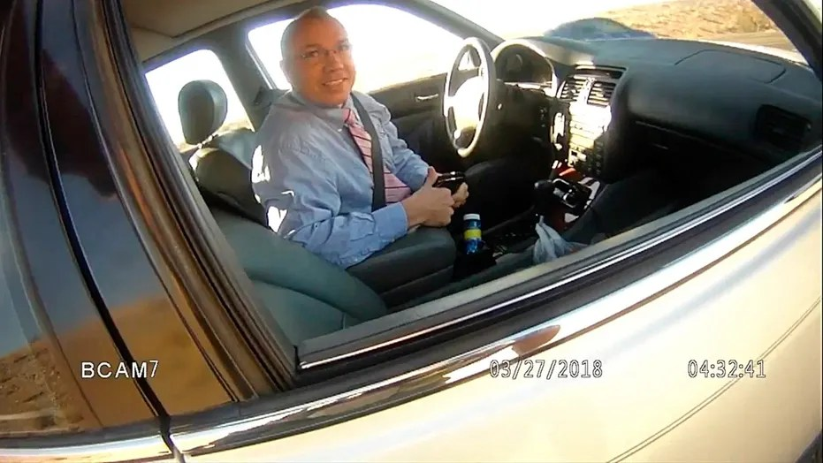 This image made from a law enforcement body camera video shows Arizona state Rep. Paul Mosley during a traffic stop outside Parker, Ariz., March 27, 2018.