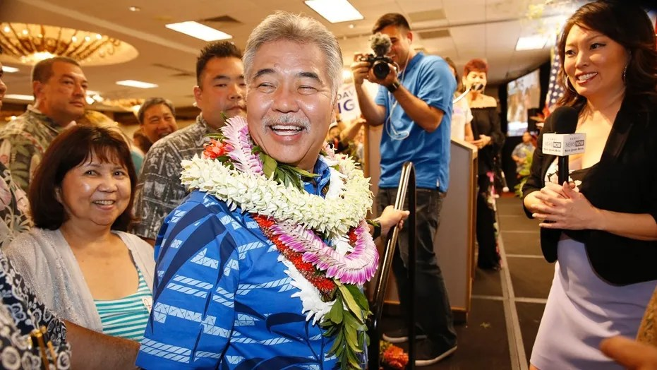 Hawaii Gov. David Ige greets supporters at his campaign headquarters, Saturday, Aug. 11, 2018, in Honolulu.