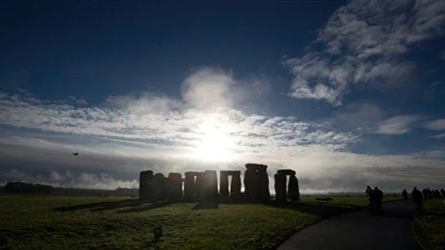 In this Tuesday Dec. 17, 2013 file photo, visitors take photographs of the world heritage site of Stonehenge, England.