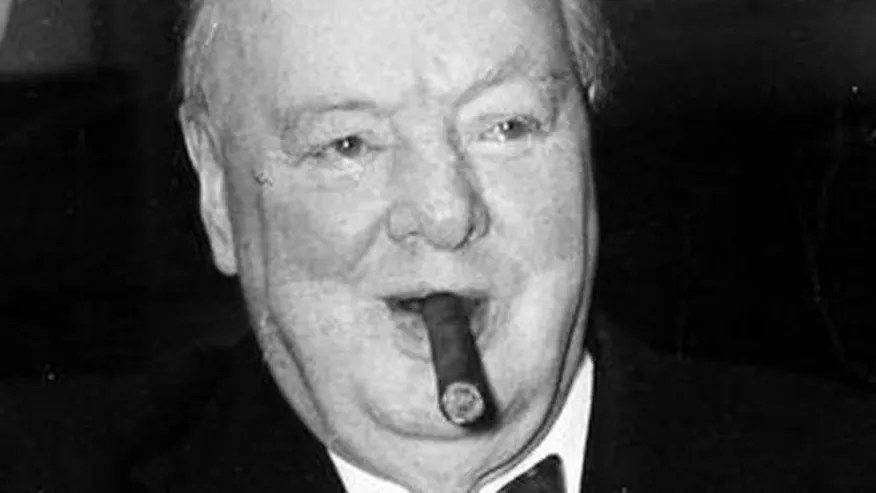 Winston Churchill is seen with his trademark cigar in this file photo.