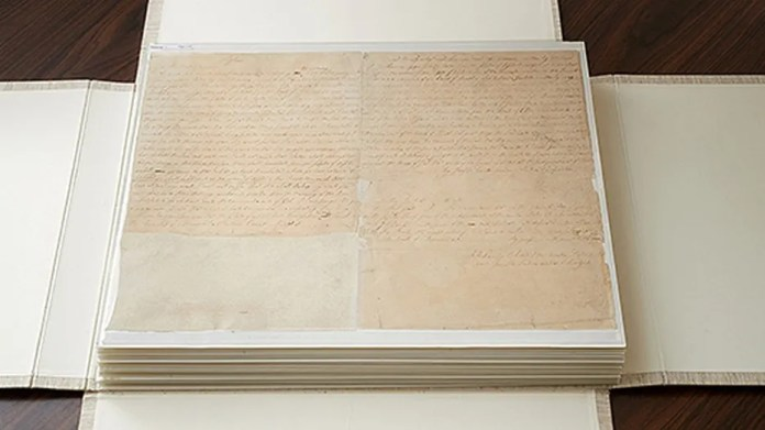 These are the first couple of pages of the printer's manuscript of the Book of Mormon. It is enclosed by folding the casing and then by sliding it into an additional case. (Credit: The Church of Ladder Day Saints)