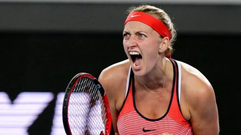 FILE - This is a Wednesday, Jan. 20, 2016 file photo of Petra Kvitova of the Czech Republic, clenches her left hand as she reacts after winning a point against Daria Gavrilova of Australia during their second round match at the Australian Open tennis championships in Melbourne, Australia. Two-time Wimbledon champion Petra Kvitova has been injured by a knife-wielding attacker at her home on Tuesday Dec. 20, 2016. The player's spokesman, Karel Tejkal, says Kvitova suffered a left hand injury and has been treated by doctors.(AP Photo/Aaron Favila, File)