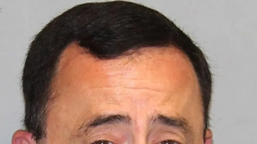 This Nov. 21, 2016 file photo provided by the Michigan Attorney General's office shows former USA Gymnastics team doctor Larry Nassar. Nassar, who has been accused of sexually abusing gymnasts, was hit with a new lawsuit filed in federal court in western Michigan on Tuesday, Jan. 10, 2017, by 18 women and girls who say they were molested by him, mostly at his clinic at Michigan State University. (Michigan Attorney General's office via AP, File)