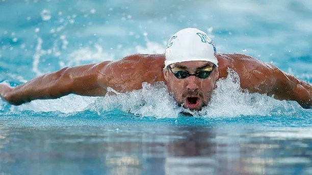 Michael Phelps swims in the 200-meter individual medley final during the Santa Clara International Grand Prix swim meet in Santa Clara, Calif., Sunday, June 22, 2014. Michael Phelps finished in third place. (AP Photo/Tony Avelar)