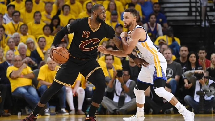 Cleveland Cavaliers forward LeBron James (23) is defended by Golden State Warriors guard Stephen Curry (30) during the third quarter in game five of the 2017 NBA Finals at Oracle Arena.