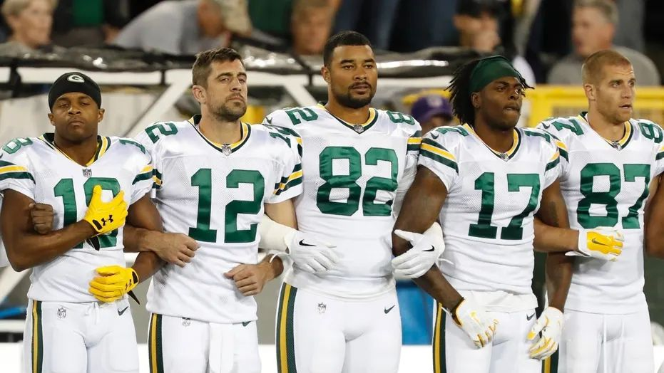 Image result for Packers and Bears stand, link arms before NFL game