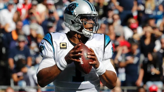 Carolina Panthers quarterback Cam Newton looks for a receiver during an NFL game in Foxborough, Mass., Oct. 1, 2017.