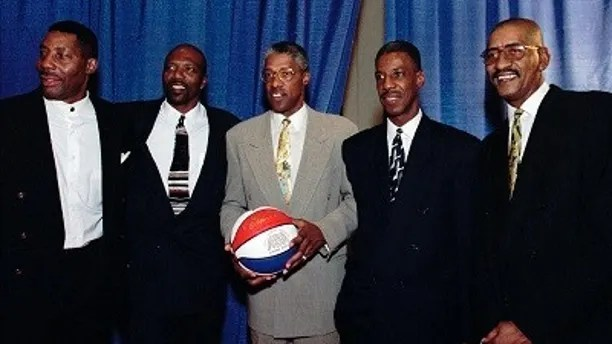 """FILE - In this Aug. 23, 1997, file photo, basketball players from left, Connie Hawkins, Marvin Barnes, Julius Erving, Charlie Scott and George Gervin pose for a photograph at the American Basketball Association 30th Reunion in Indianapolis. Basketball great Connie Hawkins has died at 75. The Hall of Famer's death was announced in a statement Saturday, Oct. 7, 2017,  by the Phoenix Suns, the team with which he spent his most productive NBA seasons. The Suns told The Associated Press they confirmed the death with his family. The 6-foot-8 Hawkins was a dazzling playground legend in New York City who rose to basketball's heights. The Suns lauded his """"unique combination of size, grace and athleticism.""""(AP Photo/Tom Russo, File)"""