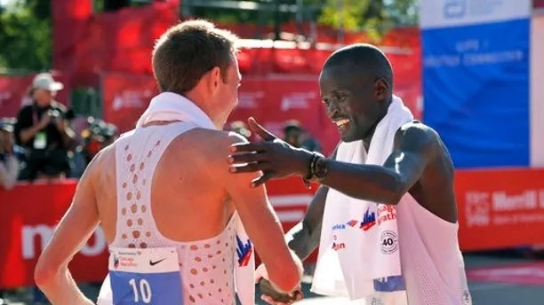 Galen Rupp left, of the United States celebrates with second place finisher Abel Kirui of Kenya after winning the 2017 Bank of America Chicago Marathon Sunday, Oct. 8, 2017, in Chicago. (AP Photo/Paul Beaty)