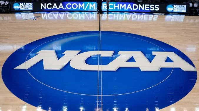 The NCAA logo is seen at center court prior to men's college basketball championship tournament games at the Consol Energy Center in Pittsburgh, March 18, 2015.